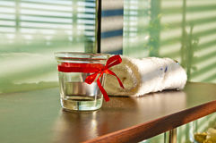 Spa and bauty salon detail - towel and candle holder. Indoor sho Royalty Free Stock Photo