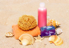 Spa beach products on the sand: towel, soap, bottle, starfish, s Stock Images