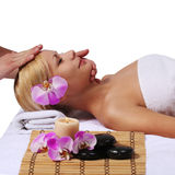 Spa. Beautiful Blonde Woman Getting Facial Massage, isolated Royalty Free Stock Image