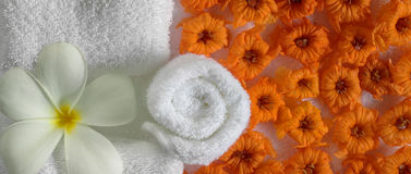 Spa beauty. Exotic tropical flowers  on white towels Royalty Free Stock Images