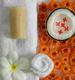 Spa beauty. Exotic tropical flowers soap on white towels coconut Stock Images