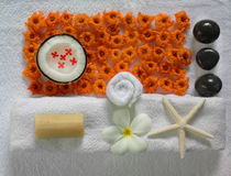 Spa beauty. Exotic tropical flowers starfish stones on white towels Royalty Free Stock Photo