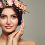 Spa Beauty. Cute Woman Spa Model with Healthy Skin. And Sweet Flowers. Beautiful Girl Smiling on Background with Copy space Royalty Free Stock Photo