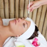 Spa beauty facial treatment oil brush and flowers Stock Photography