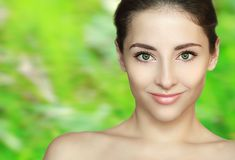 Spa beauty girl face on green Stock Images