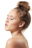 Spa beauty model with clean skin and bun hairstyle Royalty Free Stock Image