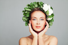 Spa Beauty Portrait of Perfect Woman with Pretty Face and Wreath. Of Green Leaves Stock Image