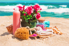 Spa beauty products: towels, soap, shells, sea salt and pink flo Stock Photo