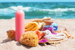 Spa beauty products: towels, soap, shells, sea salt on the sea c Royalty Free Stock Images