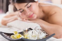 Spa beauty skin treatment woman on white towel. Gorgeous beautif. Ul multiracial Caucasian / Asian female model with perfect skin lying on towel Royalty Free Stock Images