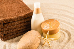 Spa beauty treatment products on sand Stock Images