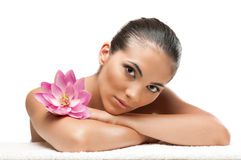 Spa beauty woman. Young beautiful woman relaxing with lotus flower at spa isolated on white background, professional beauty makeup Royalty Free Stock Photos