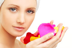 Spa beauty - woman. With rose petals royalty free stock photos