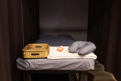 Spa bed for Thai oil massage. With towel and neck pillow stock images