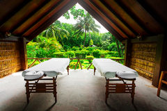 Spa beds ready to massage at outdoors tropical island Stock Photos