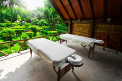 Spa beds ready to massage at outdoors tropical island Stock Photo