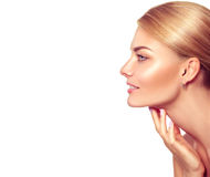 Spa blonde woman touching her face Stock Image