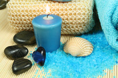 Spa in blue. Spa soothe in blue color. Wellness therapy with pebbles and candle Stock Images