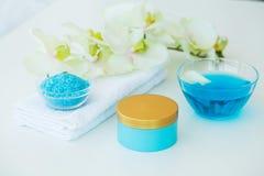 Spa. Blue Bath Salt Beauty Treatment on White Background.  Royalty Free Stock Images
