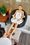 Spa Body Care. Foot Massage. Woman In Salon. Skincare Treatment Stock Photos