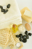 Spa body care products and towels close-up. Close-up of spa body care products wellness treatment Royalty Free Stock Image