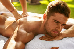 Spa Body Massage. Man Enjoying Relaxing Back Massage Outdoors Stock Images