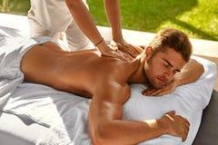 Spa Body Massage. Man Enjoying Relaxing Back Massage Outdoors Royalty Free Stock Photography