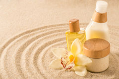 Spa body product on sand orchid flower Royalty Free Stock Photography
