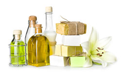 Spa bottles, soap pieces and lily isolated on white Stock Images