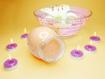Spa bowl with lily hair mask and candles Royalty Free Stock Photography