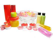 Spa bowl with rose petals and shampoo cremes Stock Photography