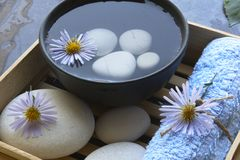 Spa bowl and stones. Spa bowl, towel and stones Royalty Free Stock Photography
