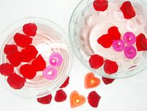 Spa bowls with red rose petals and candles Royalty Free Stock Image
