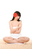 Spa brunette with flower Stock Photo