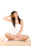 Spa brunette with flowers Stock Image