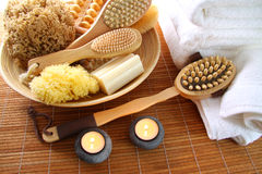 Spa brushes, sponges and soap on bamboo mat Royalty Free Stock Photo