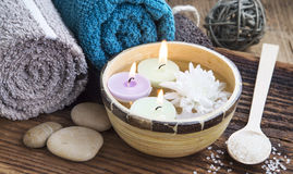 Spa.Burning Candles in the Water, Cotton Towels and Bath Salt Royalty Free Stock Photography