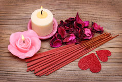 Free Spa. Burning Candles With Dried Roses Leaves, Incense Sticks Stock Photography - 36646722