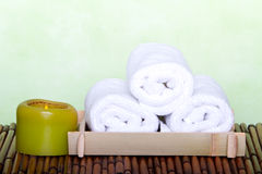 Spa candle and clean towels Royalty Free Stock Photo