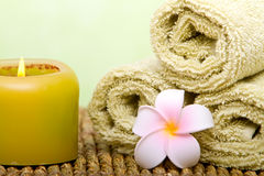 Spa candle and clean towels Stock Photo