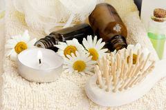 Spa candle with essence bottles Stock Photo