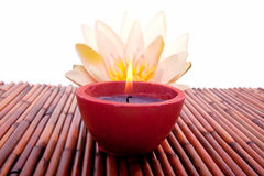 Spa candle and lotus flower for aromatherapy Royalty Free Stock Images