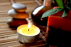 Spa candle, massage stones and oils Royalty Free Stock Photo