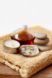 Spa candle, oil, stones and towel Stock Images