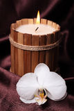 Spa candle and orchid Stock Photo