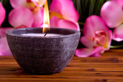 Spa candle and orchid Royalty Free Stock Images