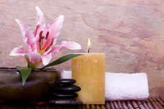 Spa candle, stones and towel Stock Image