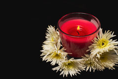 Spa candle and white chrysanthemums Stock Photo