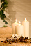Spa candles. With potpourri on brown background Royalty Free Stock Photo