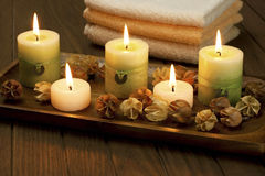 Spa candles with dried flowers Stock Photography